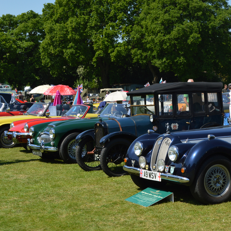 Row of classic cars linking to Classic Car Show page
